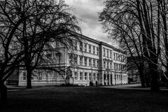 Black and White Picture of Building Surrounded by Trees Royalty Free Stock Image