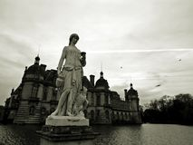 Chateau de Chantilly, Black and White Photograph with Sculpture in Foreground royalty free stock photos