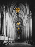 Black and white picture of city hall corridor with lanterns and pillars in Vienna rathaus. Vertical black and white photo of  Rathaus town hall arches with Royalty Free Stock Photo