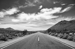 Black and white picture of the Death Valley desert road. Royalty Free Stock Images