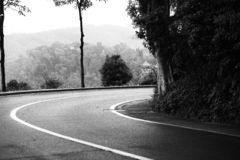 Black and white picture of an empty nature road,turn right royalty free stock photography