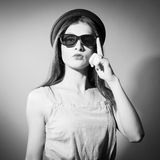 Black and white picture of exciting beautiful. Closeup portrait of beautiful exciting young lady in 3d glasses looking at camera. Black and white photography Stock Photography