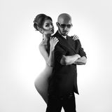 Black and white picture of fashion man with sexual naked woman Stock Photography