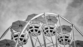 Black and white picture of a Ferris wheel. Black and white picture of Ferris wheel cars, childhood concept Royalty Free Stock Photos