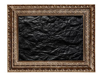 Black and white picture frame with crumpled black paper isolated Royalty Free Stock Photo