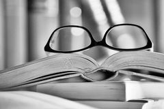 Black and white Picture of glasses on a book Stock Photos