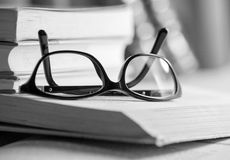 Black and white Picture of glasses on a book Stock Image