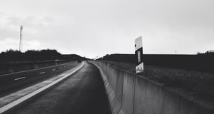 A black and white picture of a high way street in Germany Royalty Free Stock Photography