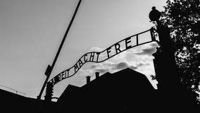 Arbeit Macht Frei. A black and white picture of the iconic entrance of Auschwitz I, with the words `Arbeit Macht Frei` above the gate Stock Image