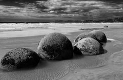 Black/white picture of the Moeraki boulders. On the Beach Koekohe Beach near Moeraki you wil see this Moeraki Boulders. Picture is black/white Stock Photo