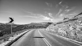 Black and white picture of a mountain road turn Stock Photos