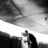 Black and white picture of newlyweds kissing tenderly on the bal Stock Photography