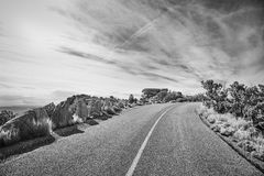 Black and white picture of a scenic road. Black and white picture of an empty road, travel concept Royalty Free Stock Photo