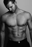 Black and white picture - sexy man posing Stock Image