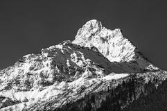 Black and white picture of snowy mountain peak Royalty Free Stock Image