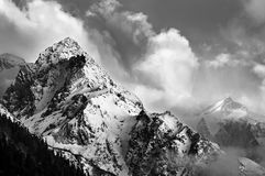 Black and white picture of snowy mountain peaks.  Royalty Free Stock Images