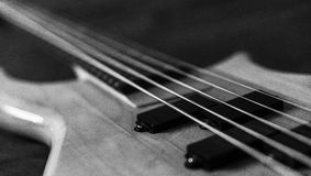 Black and white picture of a 5 string bass guitar stock images