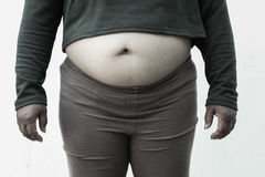Black and white picture style for Close-up of fat woman on white background. Concept for obesity issue, diet of food for health.  stock photography