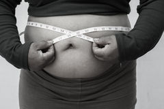 Black and white picture style for Close-up of fat woman on white background. Concept for obesity issue, diet of food for health Royalty Free Stock Photos