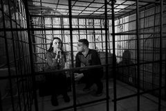 Black and white picture of two Halloween victims in a cage Royalty Free Stock Photos