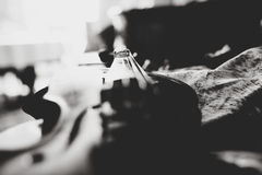 A black and white picture of wedding rings lying on the violin Stock Photography