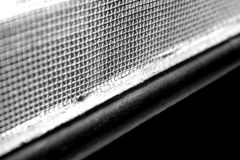 Black and white picture of a Window pane with steel grills. royalty free stock photos