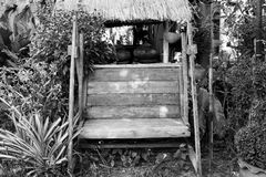 Black and white picture wooden seat royalty free stock photos