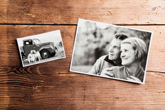 Black-and-white pictures of senior couple. Studio shot on wooden. Various black and white pictures of senior couple in love. Studio shot on wooden background stock photography