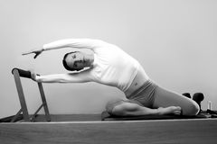 Black and white pilates woman sport Royalty Free Stock Image
