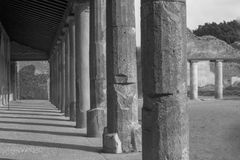 Black and white pillars in ancient city of Pompeii. Black and white pillars in ancient city Stock Photography