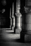 Black and white pillars. Old building pillars with texture Stock Photography