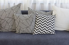 Black and white pillows on blue sofa in living room Royalty Free Stock Photos