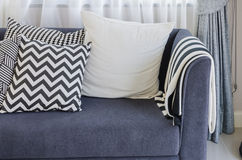Black and white pillows on blue sofa in living room Stock Images