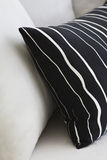 Black & white pillows in a modern interior. Arrangement of black and white pillows in a modern interior Royalty Free Stock Photography