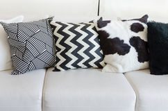 Black and white pillows on white sofa in living room at home Royalty Free Stock Photography