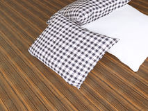 Black and white pillows on the wooden parquet Royalty Free Stock Images