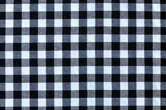 Black and White Plaid Textile Fabric Texture. Image of seamless black and white plaid textile fabric texture for abstract background royalty free stock photography
