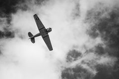 Black and white plane on the sky Royalty Free Stock Photos