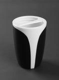 Black-white plastic toothbrush holder. On gray background Royalty Free Stock Images