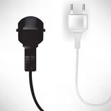 Black and white plug in cables Stock Images