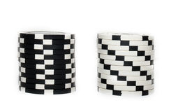 Black and White Poker Chips. On white background Royalty Free Stock Photos