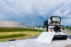 Black and White Polaroid Instant Camera With Photo Paper Stock Image