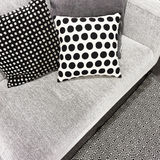 Black and white polka dot cushions on a sofa Stock Photography
