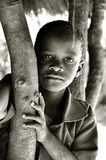 Black and white portrait of african boy. Black and white portrait of Beautiful african little boy in the village hut Stock Photography