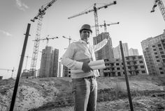 Black and white portrait of architect posing on building site Royalty Free Stock Photography