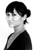 Black and white portrait of Asian woman. With bangs, black shirt, and hair in bun with bangs Royalty Free Stock Photo