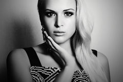 Black and white portrait of beautiful blond woman. beauty girl in dress Royalty Free Stock Image