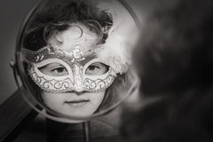 Black and white portrait of a beautiful girl in carnival mask lo Stock Images