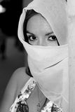 Black and white portrait of beautiful Muslim girl. A portrait of a young arab woman in a light scarf Royalty Free Stock Photography