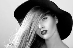 Black and white portrait of beautiful sexy woman in black hat Royalty Free Stock Image